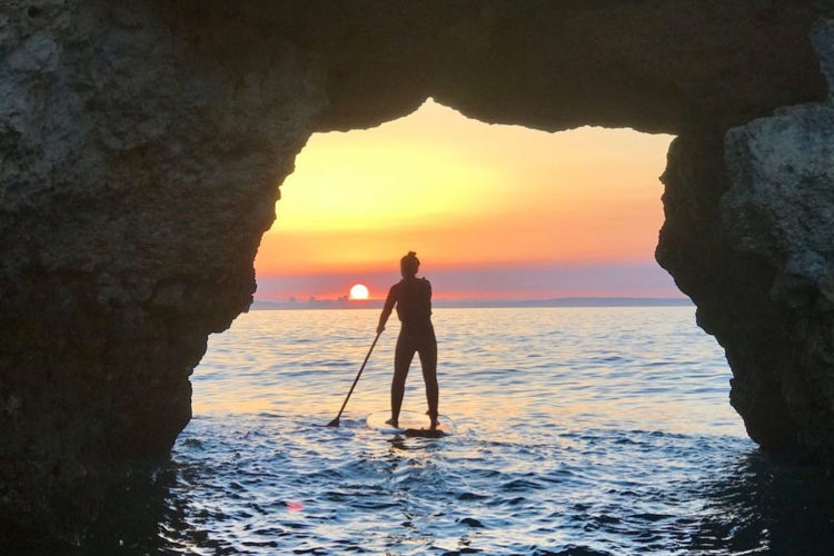 Explore the grottos of the Algarve on a sunset SUP hire from AltaVista