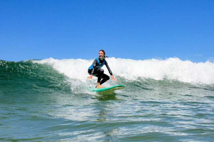 Riding the waves with surf lessons booked through AltaVista