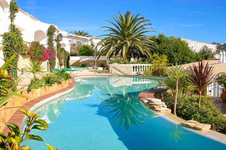 The swimming pool is large and clear blue and is a wonderful addition to Ocean Villas Luz, Algarve, Portugal